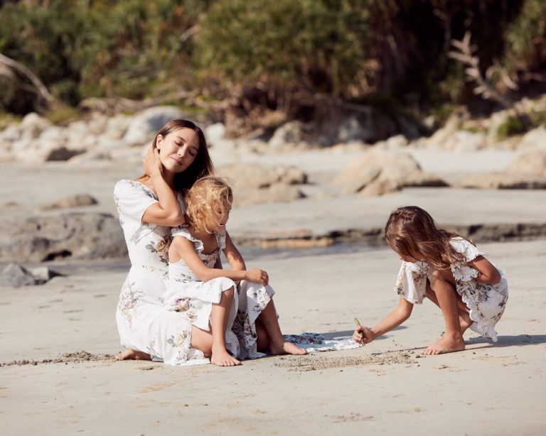 Cara G on the beach with children