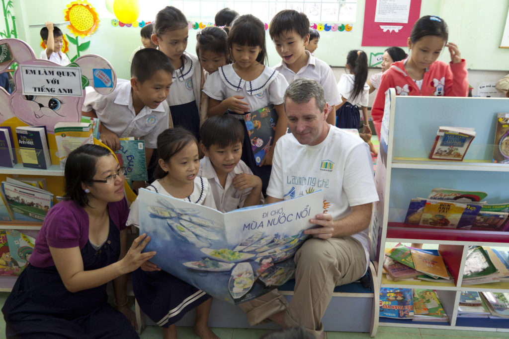 John reading to children at a Room to Read School in Vietnam